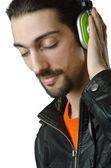 Student som lyssnar på musik — Stockfoto