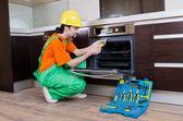 Repairman assembling the furniture at kitchen — Stock Photo