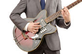 Guitar player in business suit on white — Stock Photo