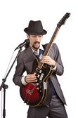 Businessman playing the guitar on white — Stock Photo