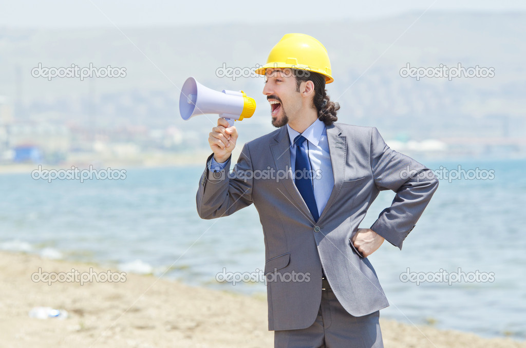 Man wearing helmet speaks with megaphone — Stock Photo #11174105