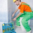 Plumber working in the bathroom — Foto de Stock