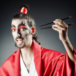 Stock Photo: Japanese actor with chopsticks