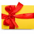 Envelope with colourful ribbon on white — Stockfoto
