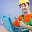 Repairman with his toolkit - Stock Photo