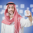 Young arab pressing virtual buttons — Stock Photo