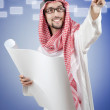 Young arab pressing virtual buttons — Stock Photo #11316708