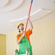 Painter worker during painting job — Stock Photo #11316908