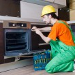 Repairman assembling the furniture at kitchen — Stock Photo #11316990