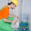 Plumber working in the bathroom — Stock Photo #11316994