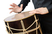 Drummer with drum playing on white — Stock Photo