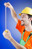 Repairman with measuring tape — Stockfoto