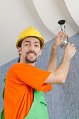 Electrician repairman working on refurbishment — Stockfoto