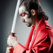 Japanese actor with sword — Stock Photo #11399180