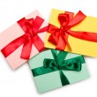 Envelope with colourful ribbon on white — Стоковая фотография