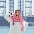 Arab with footbal at seaside — Stock Photo #11399384