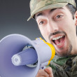 Soldier with loudspeaker shouting — Stock Photo #11399589