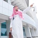 Arab on the street in summer — Stock Photo #11399653
