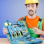 Repairman with his toolkit — Stock Photo #11399665