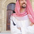 Arab on the street in summer — Stock Photo #11399721