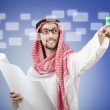 Young arab pressing virtual buttons — Stock Photo #11399809