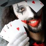 Joker with cards in studio shoot — Stock Photo #11399815