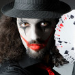 Joker with cards in studio shoot — Stock Photo #11399817