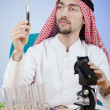 Arab chemist working in lab — Stock Photo #11399826