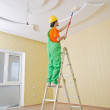 Painter worker during painting job — Stock Photo
