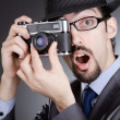Photographer man with vintage camera — Stock Photo #11400281
