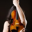 Female violin player against background — Stock Photo #11400301