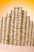 Golden coins in high stacks — Stock Photo