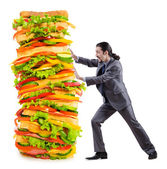 Man and giant sandwich on white — Foto de Stock