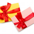 Envelope with colourful ribbon on white — 图库照片