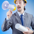Construction worker shouting via loudspeaker — Stock Photo #11578962