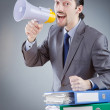 Businessman shouting via loudspeaker — Stock Photo #11579002