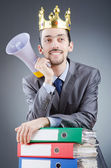 Man with crown and loudspeaker — Stock Photo
