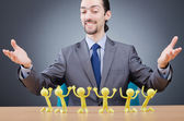 Boss with figures of his subordinates — Stock Photo