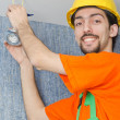 Electrician repairman working on refurbishment — Stock Photo
