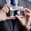 Photographer man with vintage camera — Stock Photo #11582566