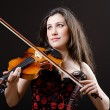 Female violin player against background - Lizenzfreies Foto