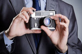 Photographer man with vintage camera — Stock Photo