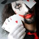 Joker with cards in studio shoot — Stock Photo #11636463