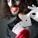 Joker with cards in studio shoot — Stock Photo #11636466
