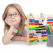 Girl with abacus on white - Stockfoto