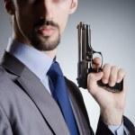 Businessman man with hand gun — Stock Photo #11636840