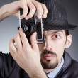 Photographer man with vintage camera — Photo
