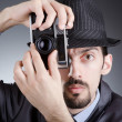 Photographer man with vintage camera — Stockfoto
