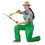 Girl with garden scissors on white — Stock Photo