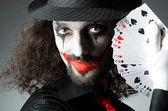 Joker with cards in studio shoot — Stock Photo